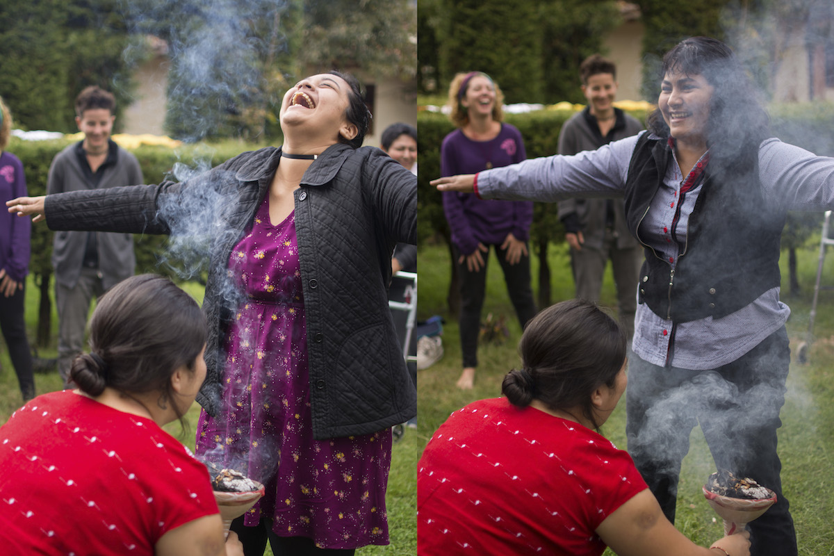 Two women are being smudged