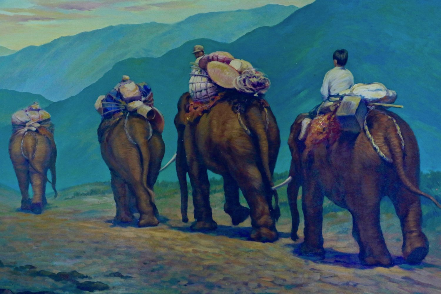 painting of people riding elephants in mountains