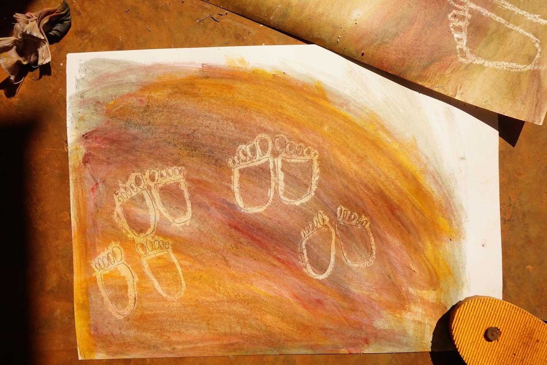 painting of bare feet on mud