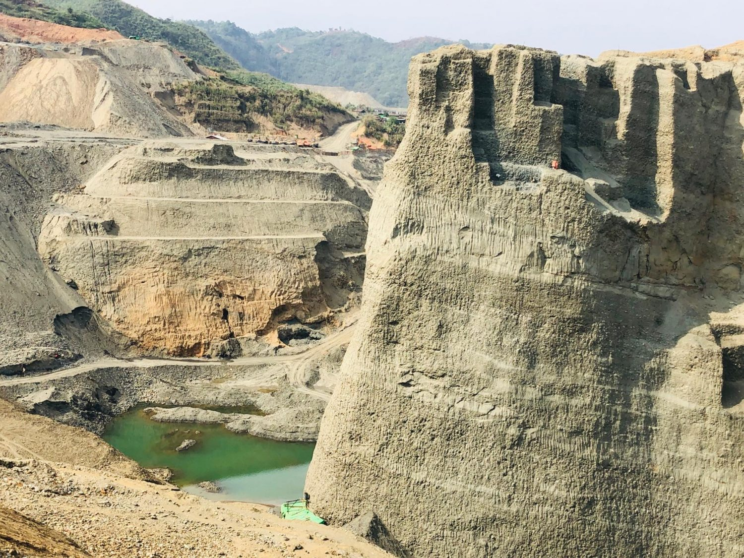 towering cliffs with tiny artisanal miners