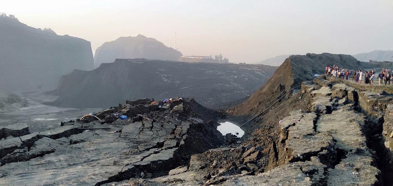 browen ground where landslide destroyed worker's camp