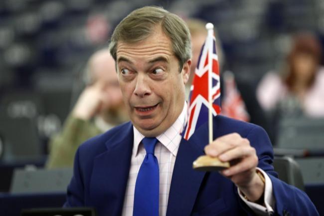 Image of Nigel Farange holding a UK flag with bulging eyes.