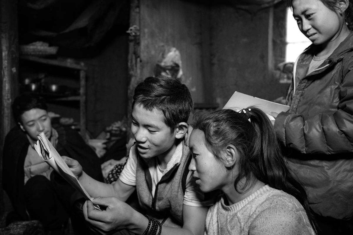 Grandson teaching his sisters Nuosu language