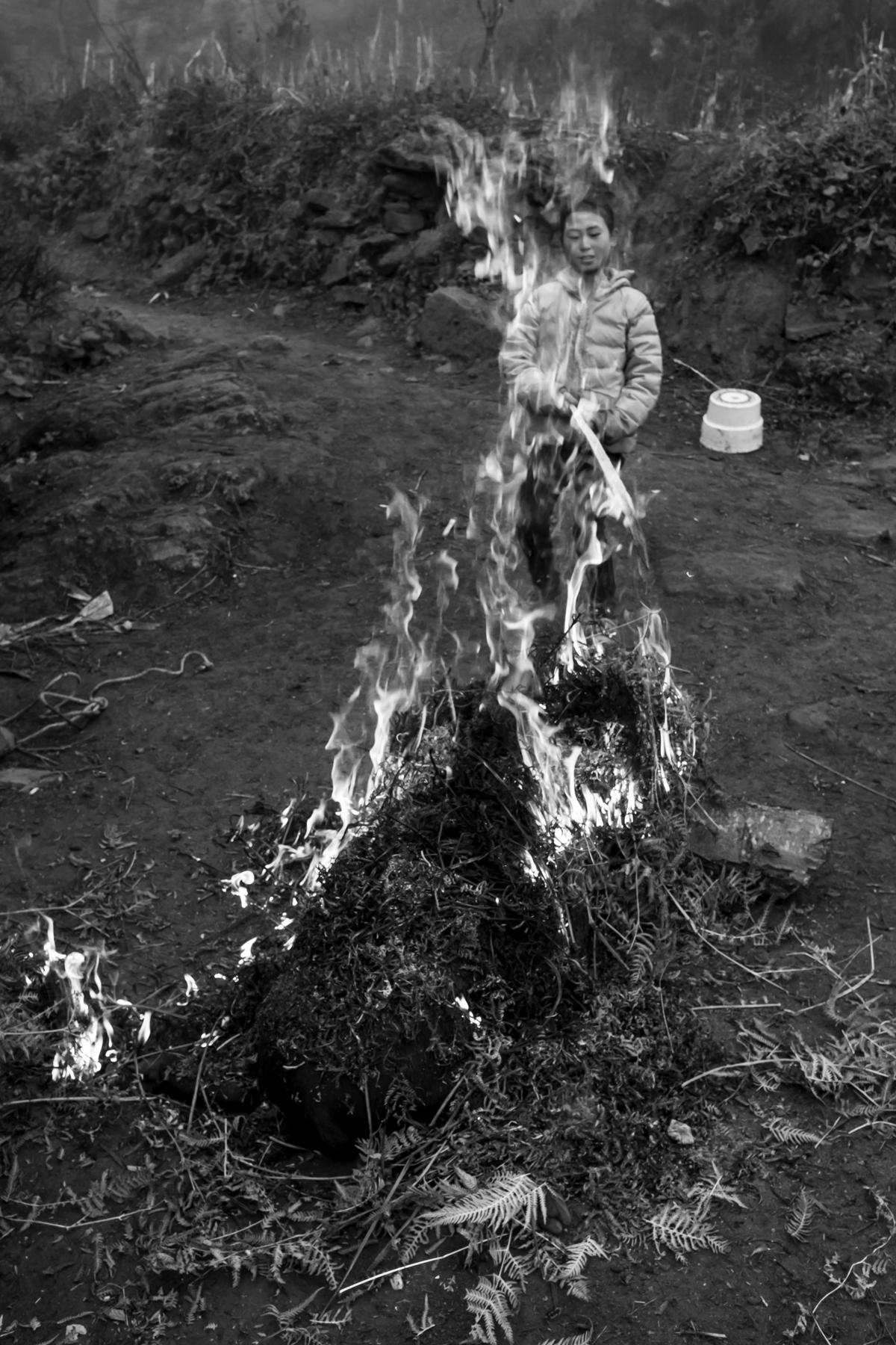 Granddaughter tending the fire