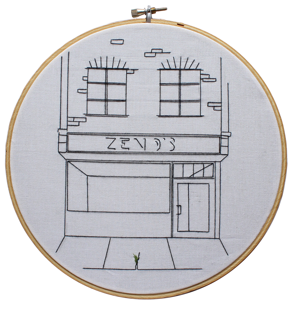 Embroidery of a restaurant's exterior. There is a small crack in the sidewalk, with a aplant beginning to grow from it.