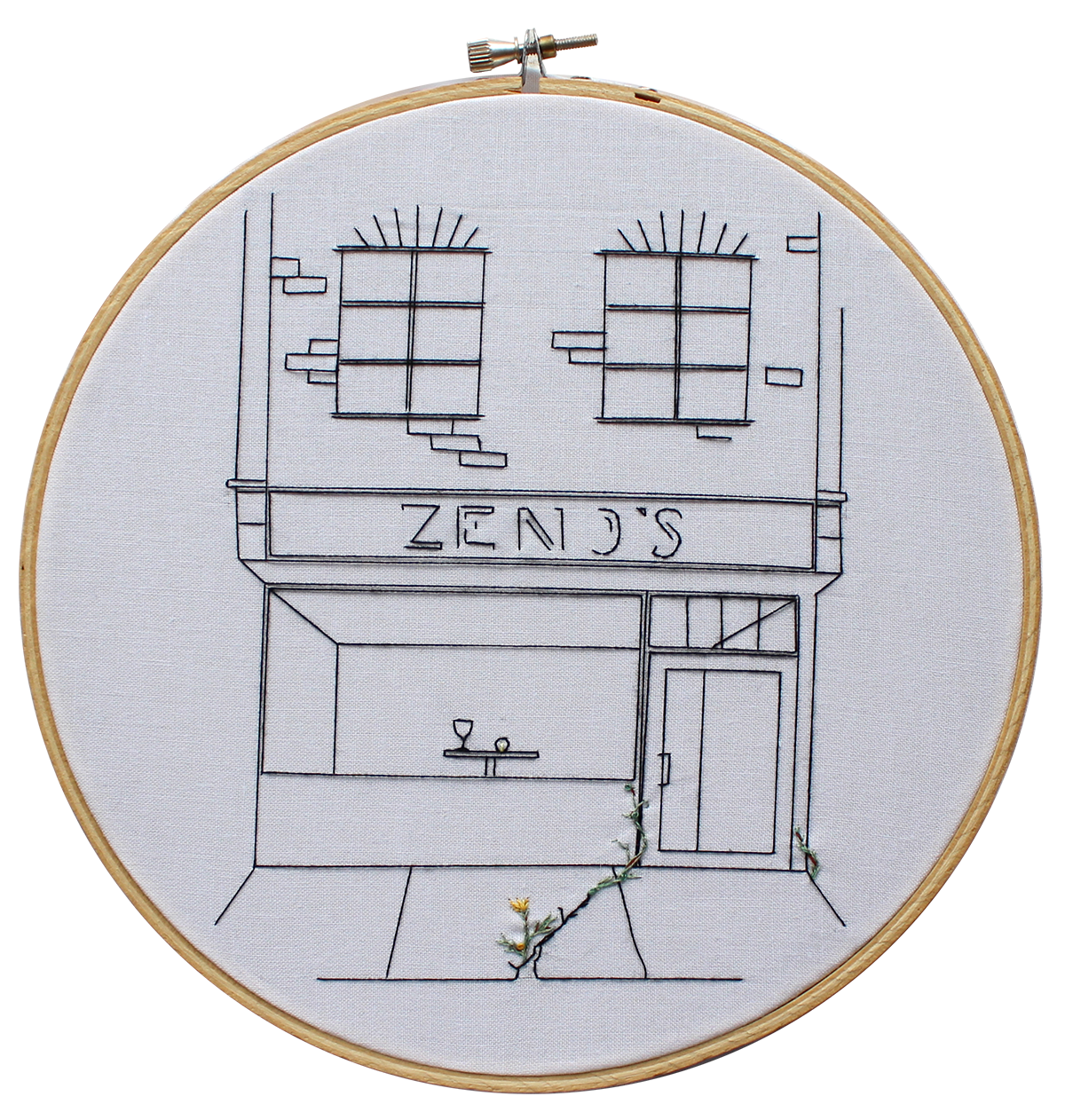 Embroidery of a restaurant's exterior. There is a crack in the sidewalk, with a plant growing in the crack
