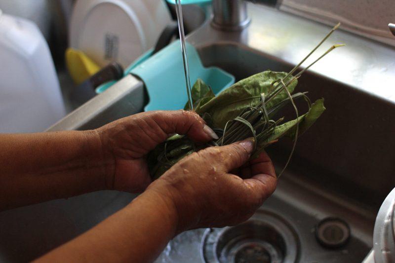 woman prepares herbal tea in kitches