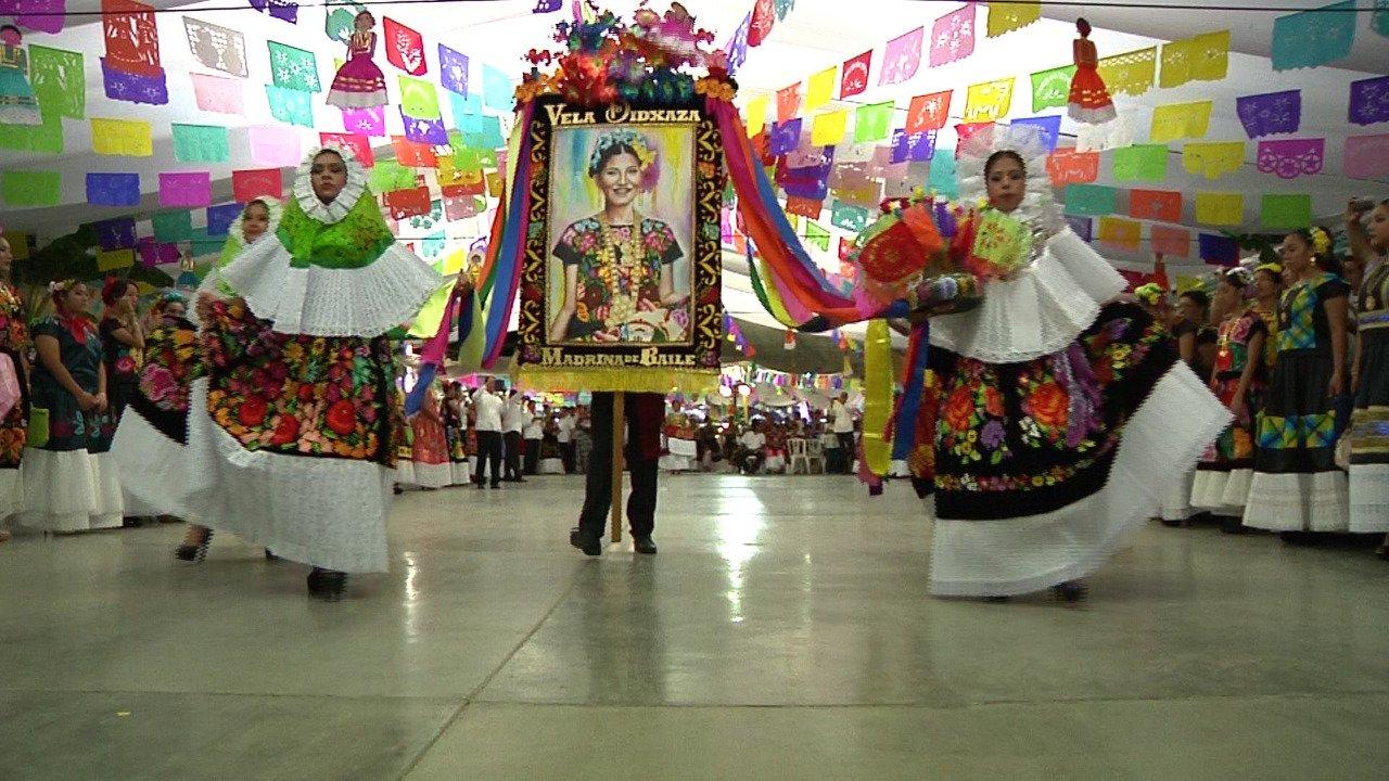 Woven wearing ornate handsewn dressed at a vela Fiesta in Oaxaca