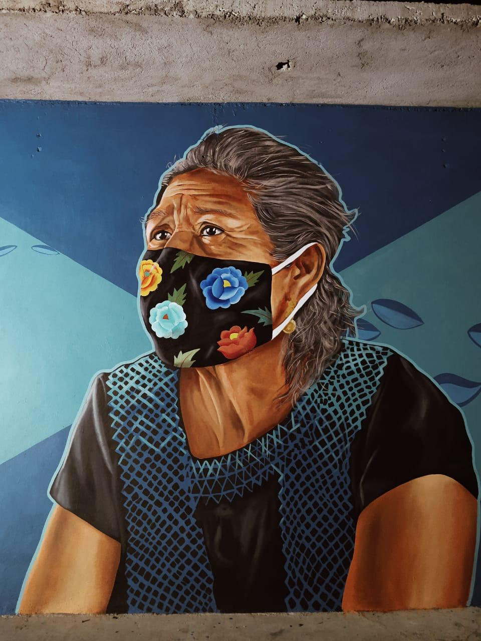 Elderly Zapotec woman wearing a floral mask