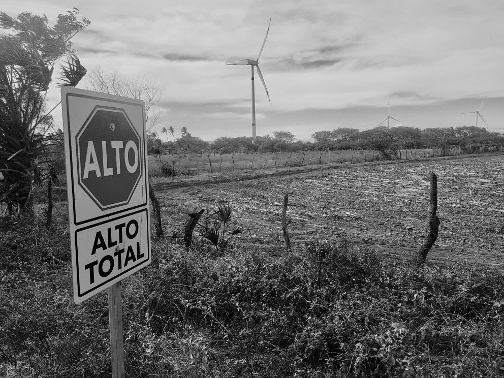 stop sign in wind park farmland