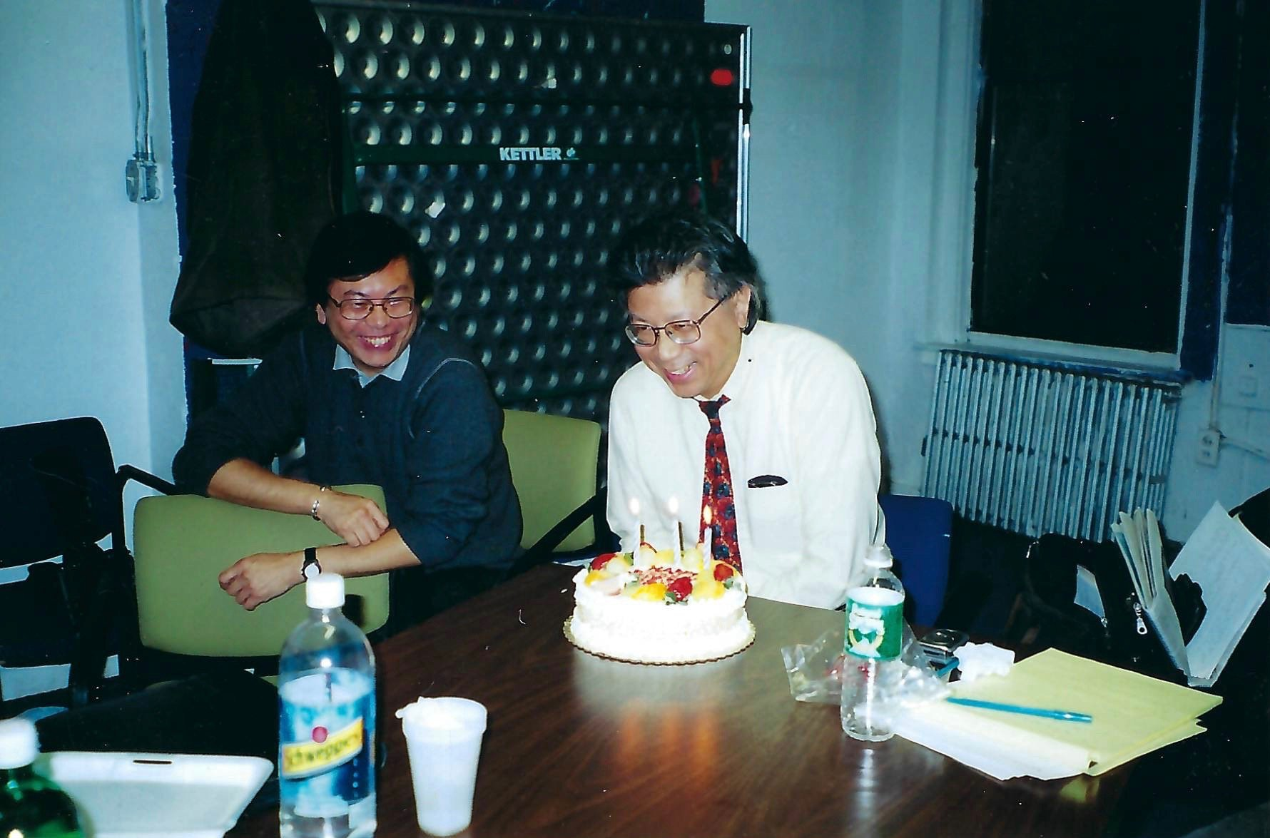 Corky Lee blowing out candles at his birthday party
