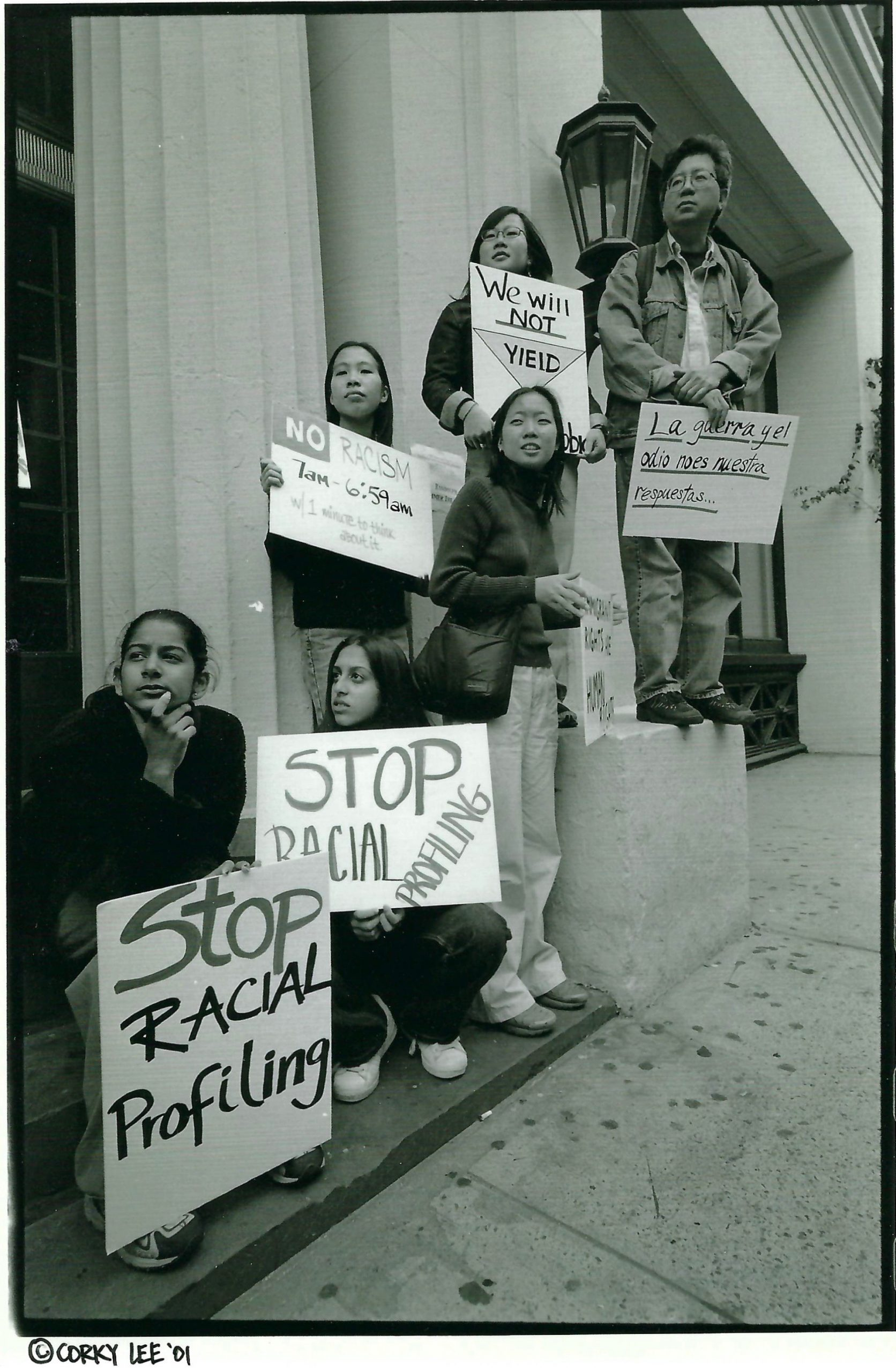 b&w image of Asian American protesters holding signs