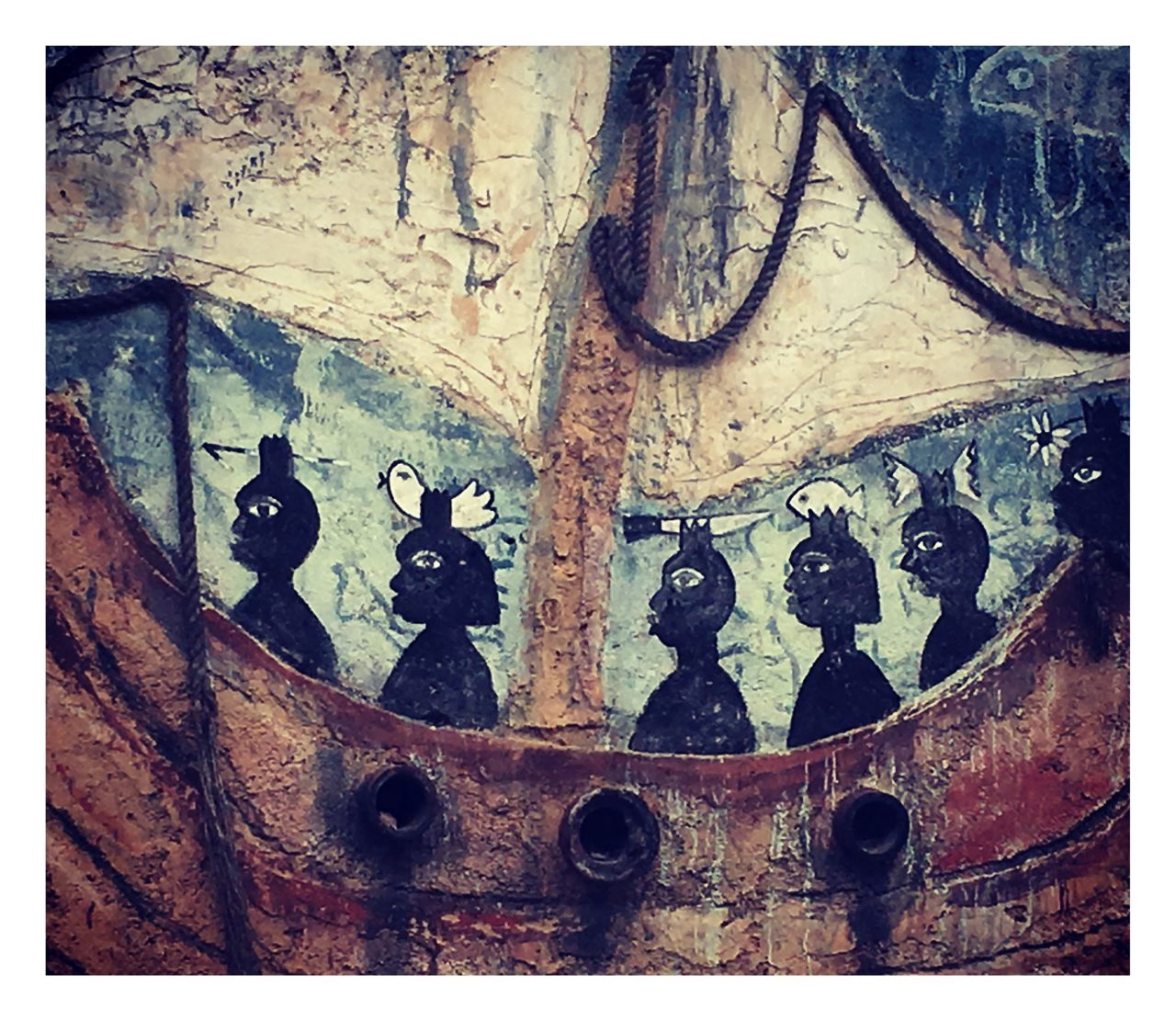 Street art from Matanzas, Cuba depicting African slaves on ship with animals in their hair.