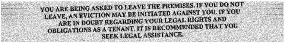 grainy image of eviction notice text