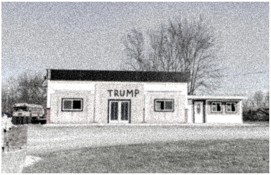 """Grainy image of a house with the word """"Trump"""" painted above the front door"""